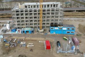 Tekort aan personeel en materiaal remt bouwproductie
