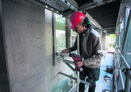 Groot Handelsgebouw dingt met herstelde gevels naar betonprijs