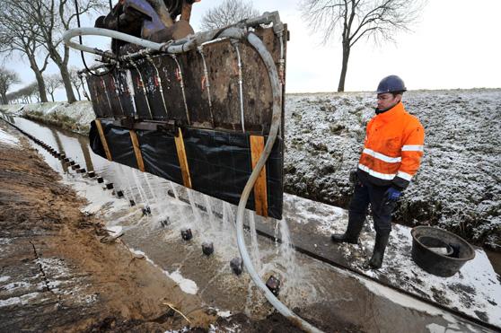 Bouwfoto van de Dag: Snel werken op instabiele walkant