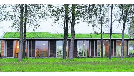 Ecologisch gebouw van hout waarin patiënt centraal staat